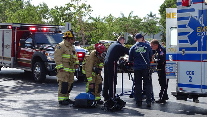 Firefighters and paramedics tend to a construction worker who suffered an electric shock while working at a Naples construction site off Park Street and fell about 25 feet, Thursday, Nov. 30, 2017.