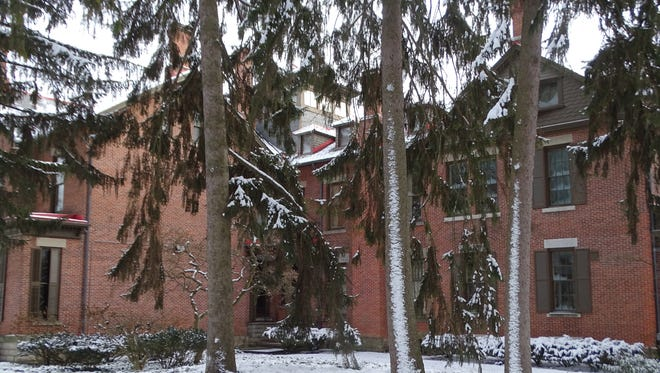Snow blankets the trees around the Rutherford B. Hayes Home on Tuesday, where sleigh rides were canceled due to negative wind chill temperatures.