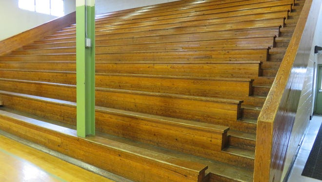 The home grandstand of the former Bearden High gym features fine woodwork.