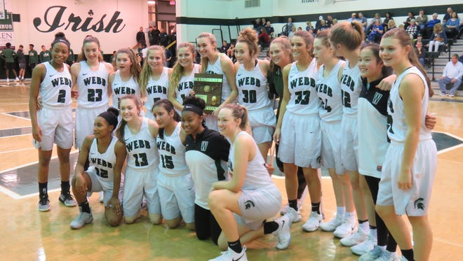 The Webb girls basketball team poses with its championship plaque Saturday.