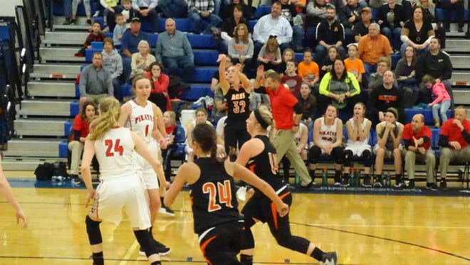 Amanda-Clearcreek's Alyssa Evans shots a 3-pointer Tuesday night in a Division III district semifinal against Cardinton. Evans scored 35 points to help the Aces pull off a 56-55 upset win over the No. 2-seeded Pirates.