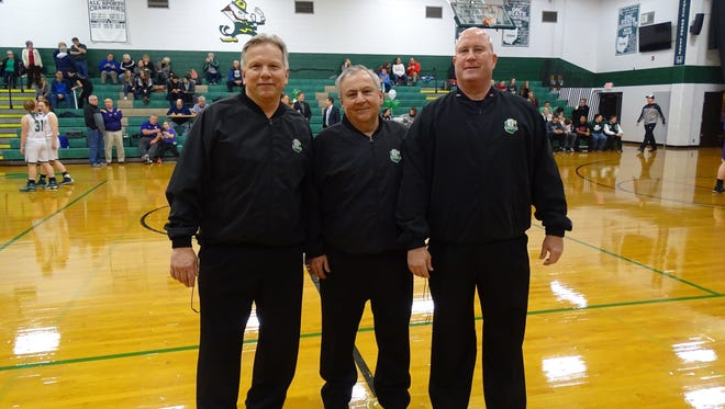 Wayne Roller, center, stands beside Ed Nicewicz, left, and Randy Swartz before officiating a game at Fisher Catholic. It was Roller's last game after 40 years of officiating. He passed away last year at the age of 64. On March 4, he was inducted into the Mid-state League Hall of Fame.