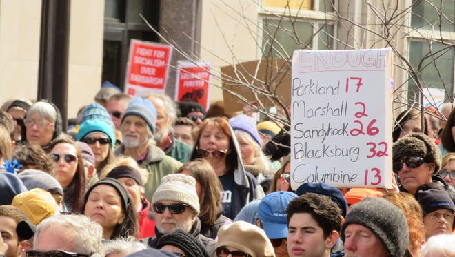 Scenes from the March for Our Lives rally at the Ithaca Commons on Saturday, March 24. About 1,000 people gathered for the rally.
