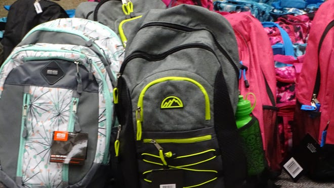 Members of Leadership Sandusky County filled 120 backpacks with a variety of essential items to be given to area foster children. The bags were presented to Sandusky County Children's Services Thursday in recognition of Child Abuse Prevention Month.