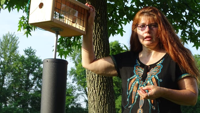 Bishop Flaget teacher Carrie Hill talks about one of the bird feeder stations that helped earn the school a Wild School Site designation from the Ohio Division of Wildlife.