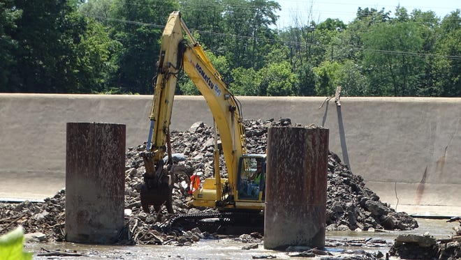 Work continued Friday on building a temporary construction road near the Ballville Dam, with demolition of the 105-year-old structure scheduled to begin next week.