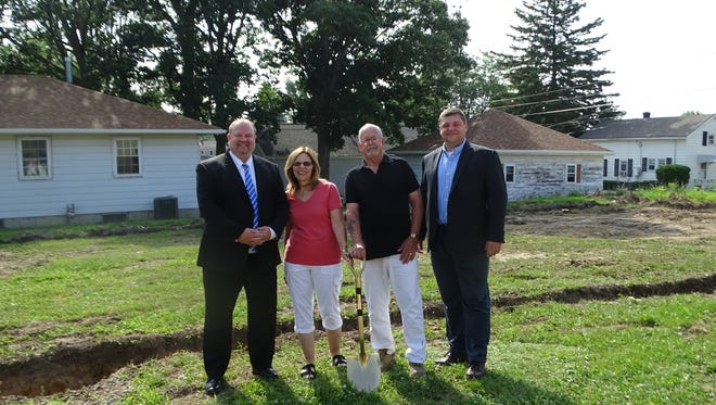 From left, Ron Grindle of Fremont Federal Credit Union, daycare owners Marsha and Scott Williams, and executive assistant to the mayor Bob Gross get ready to break ground with a golden shovel for the new Easter Seals adult daycare facility.