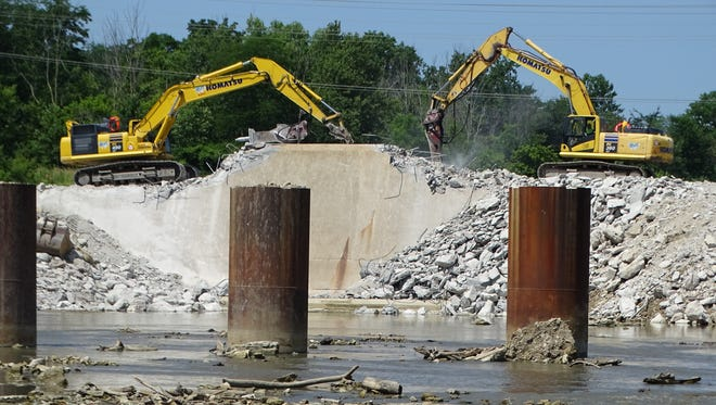 Work continued Wednesday on the Ballville Dam demolition project. MWH Constructors and the Great Lakes Construction Co. started removing portions of the 105-year-old dam on July 2.