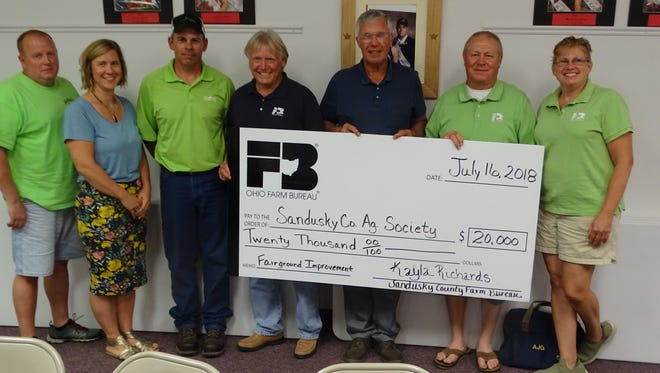 The Sandusky County Farm Bureau presented a check for $20,000 to the Sandusky County Agricultural Society Monday night. This contribution is being made to the Ag Society's capital campaign to raise money for the improvements and maintenance of the Sandusky County fairgrounds.