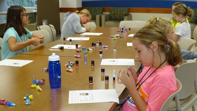 Children in the DIY Spa Party class paint their nails.  Later in the week they'll learn how to make bath bombs and scrubs.