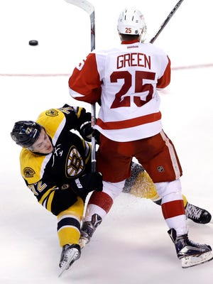 Mike Green gets tangled up with Frank Vatrano during the Red Wings' loss Thursday night.
