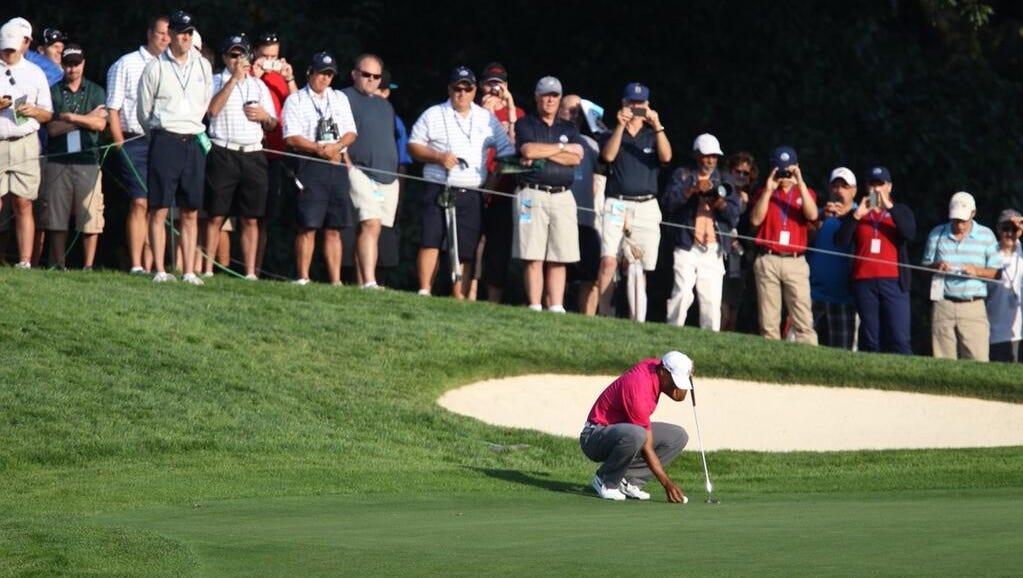 A large gallery follows Tiger Woods Wednesday.