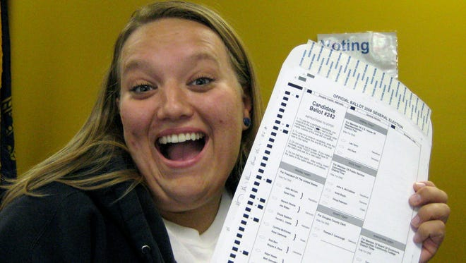 Nikola Halycyone Jordan poses with her election ballot in Omaha, Neb. Jordan believes the selfies are a great way not only to share her views on the issues, but also to stress the importance of voting and being civically active.