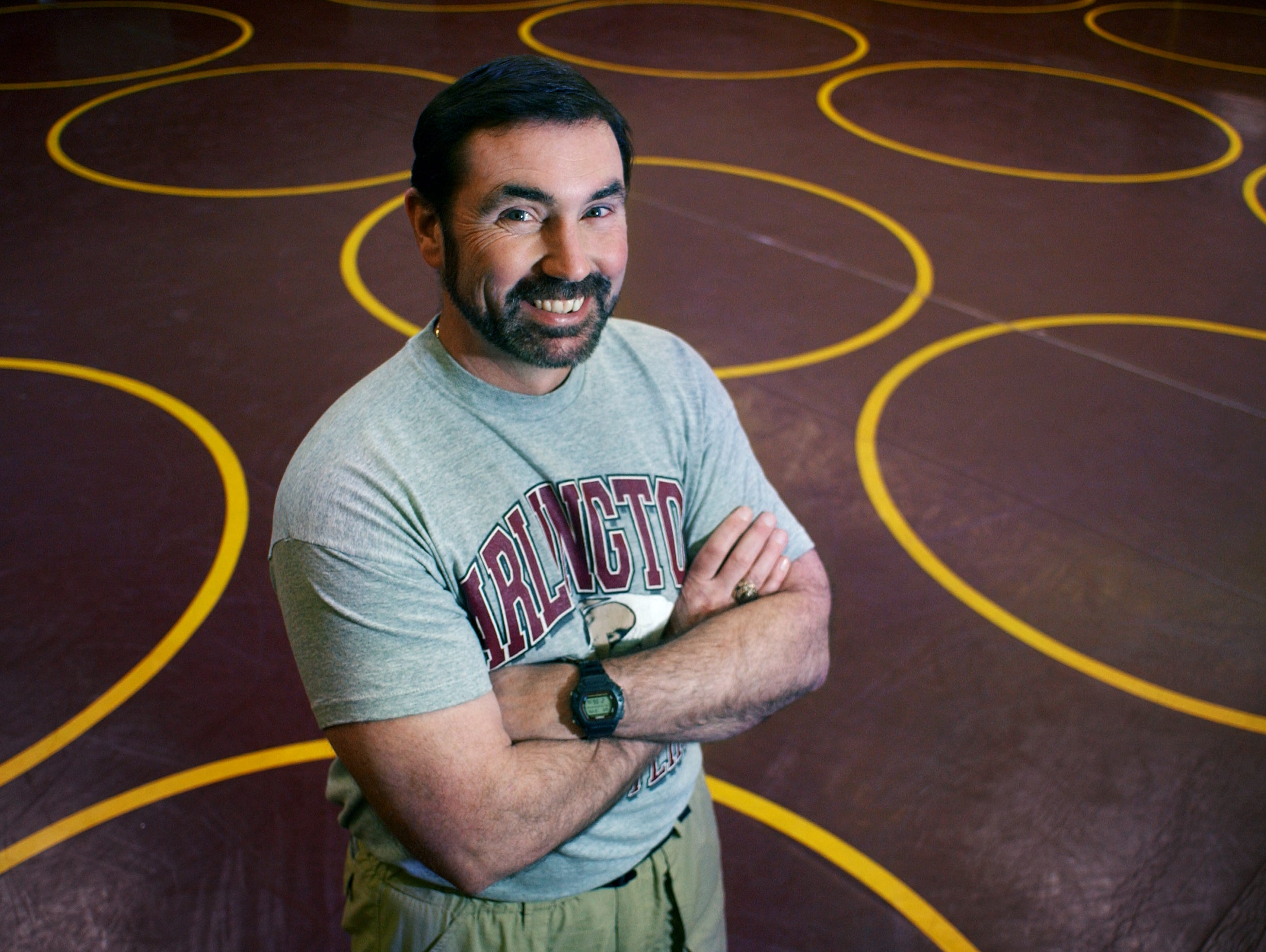 Arlington coach Fred Perry stands for a portrait in the school's wrestling room after he was named the Journal's Wrestling Coach of the Year in 2003.
