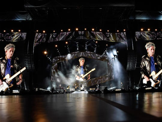 Rolling Stones guitarist Keith Richards is seen on video screens during the band's June 17 performance in Nashville, Tenn.