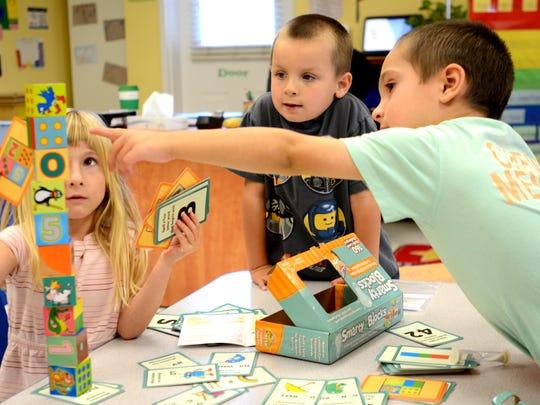 Chris Leone, right, Ryan Morris and Ava Wozniak play with the Smarty Blocks during class at The Goddard School in Sparks on Monday, Oct. 6, 2014.