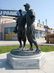 A statue of Pee Wee Reese and Jackie Robinson at MCU