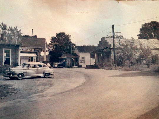 This Hooper family picture shows downtown Milton in 1954. According to a note under the photo, Rakes Garage is on the left and Old store and Cherry's store are on the right. An old Hooper family picture of Downtown Milton in 1954. According to a note under the photo Rakes Garage is on the left and Cherry's Grocery, soon to open as The Gathering at Milton, is located on the right.