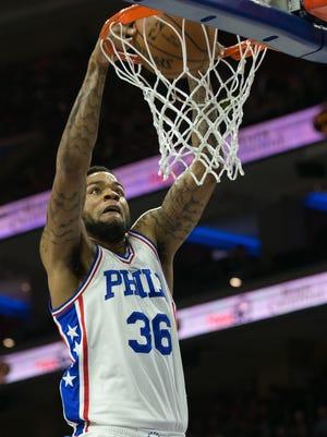 Philadelphia 76ers forward Shawn Long (36) dunks the ball against the Brooklyn Nets on April 4at Wells Fargo Center.