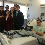 Lexington High School alumnus Zach Betscher received his diploma from the University of Akron in the hospital on Dec.17. He had his appendix removed the day before.
