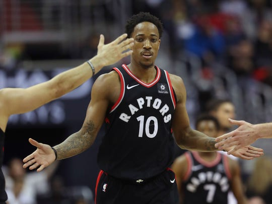 Toronto Raptors guard DeMar DeRozan (10) is greeted by teammates after scoring against the Washington Wizards during the second half of an NBA basketball game Friday, March 2, 2018, in Washington. Toronto won 102-95. (AP Photo/Pablo Martinez Monsivais) ORG XMIT: VZN112