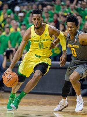 Oregon Ducks forward Troy Brown (0) drives to the basket against Arizona State Sun Devils guard Tra Holder (0) during the first half at Matthew Knight Arena.