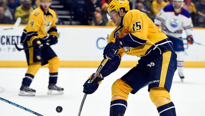 Predators center Craig Smith, Nashville's most prolific scorer since the start of the 2013-14 season, takes a shot during the third period against the Oilers on Saturday.