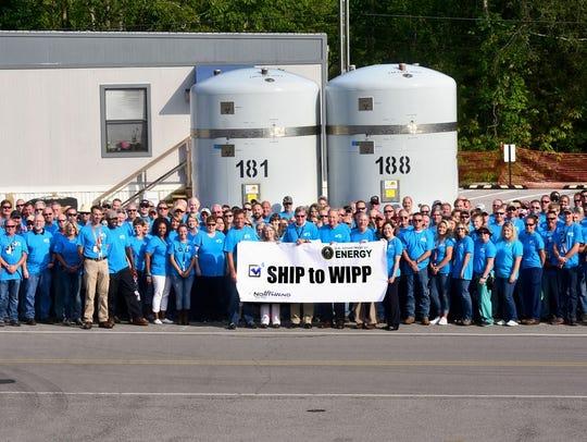 Employees celebrate shipment