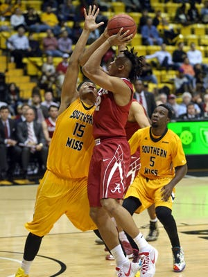 Alabama's Dazon Ingram attempts to shoot over Southern Miss' Eddie Davis III during a game last week at Reed Green Coliseum.