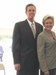 John Hamilton, left, and then-Gov. Jennifer Granholm