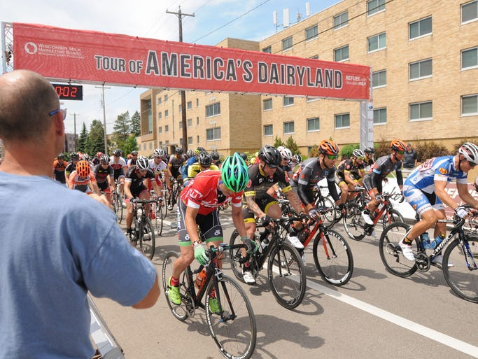 Races went all day as the Masters 1/2 35 plus category gets underway.  The Oshkosh Criterium de Titan is part of the Tour of America's Dairyland bike race that was held on the campus of UW-Oshkosh.  Over a thousand cyclists participated in the event in Oshkosh June 26, 2014.