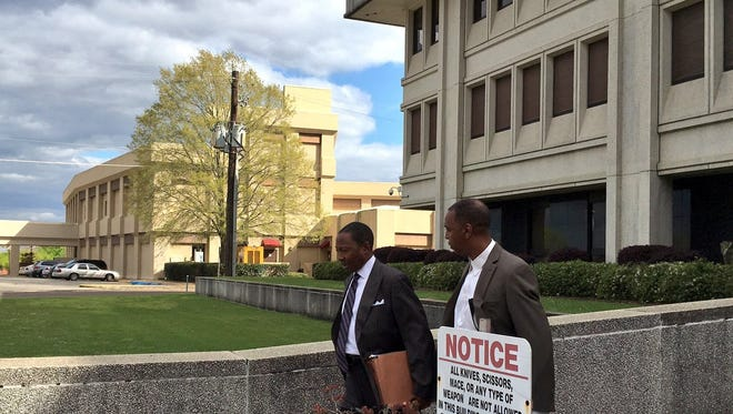 Artie Fletcher, right, leaves federal court in March with attorney Clarence Roby Jr. after Fletcher and the Rev. Kenneth Fairley were arraigned on multiple charges. Fletcher pleaded guilty Friday to misprision of felony.
