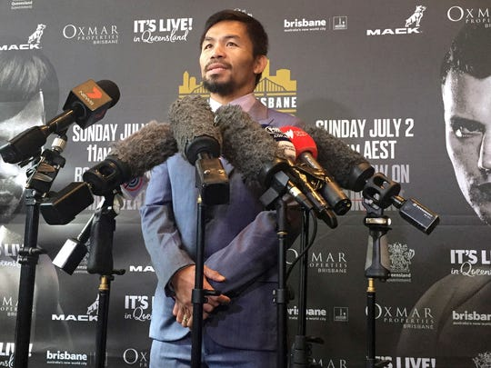 Famed boxer Manny Pacquiao of the Philippines speaks to the media during a press conference with Jeff Horn of Australia in Brisbane, Wednesday, June 28, 2017. Pacquiao, is putting his WBO belt on the line Sunday, July 2, against the 29-year-old Horn. (AP Photo/John Pye)
