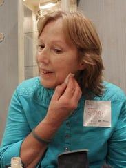 Joan Schultz of Brick applies makeup at a makeover
