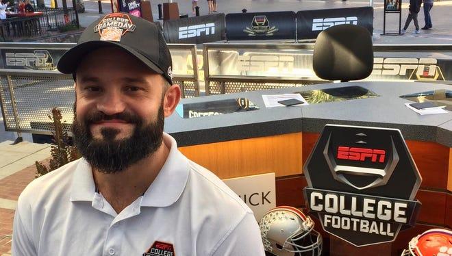 Blake Anthony, a 2003 Satellite High graduate, smiles Thursday on the ESPN College GameDay stage in Glendale, Arizona.