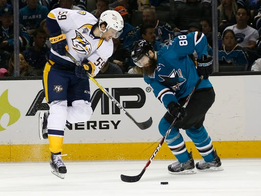 Nashville Predators defenseman Roman Josi (59) jumps over San Jose Sharks defenseman Brent Burns (88) stick during the second period of Game 2 in an NHL hockey Western Conference semifinal series Sunday, May 1, 2016, in San Jose, Calif. (AP Photo/Tony Avelar)