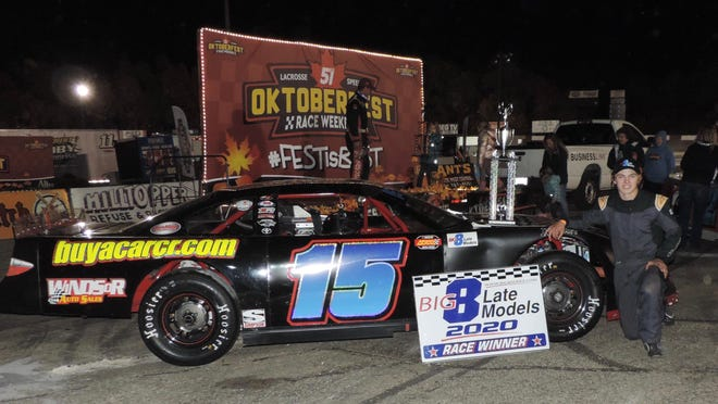Caledonia's Max Kahler kneels next to his car after winning the Big 8 Late Model season points title at the La Crosse (Wisconsin) Fairgrounds Speedway on Saturday.