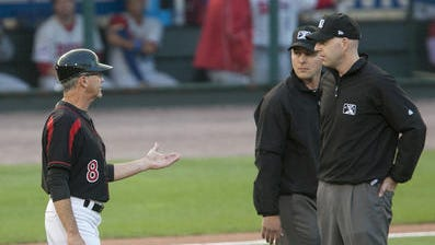 Wings manager Gene Glynn has a discussion with the umps during a July game at Frontier Field.