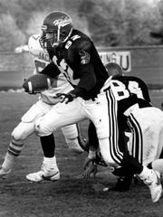 St. Cloud State football player Brent Otto runs with the ball against the University of South Dakota in 1987 at Selke Field. He played for the Huskies from 1985-89. His son, Cole, is a sixth-year senior for the Huskies this fall.
