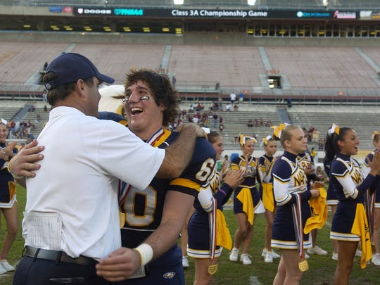 Naples head coach Bill Kramer gives Kurt Hussey a hug after the 2007 FHSAA 3A Football Finals at the Citrus Bowl in Orlando. Naples won the game 17-10 on Dec. 14, 2007. The 10-year anniversary of the Golden Eagles' second state championship was this week.
