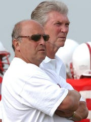 Current Wisconsin athletic director Barry Alvarez (left) believes the financial commitment to bringing baseball back is too great, while former athletic director Pat Richter eliminated the sport.