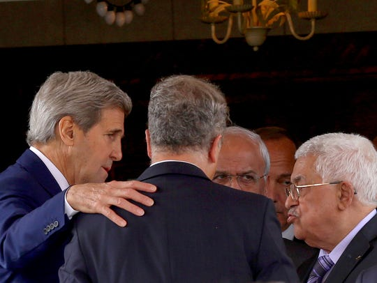 U.S. Secretary of State John Kerry, left, speaks with