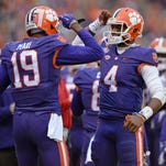 Clemson wide receiver Charone Peake (19) salutes quarterback Deshaun Watson (4) after the two connected on a 45 yard TD against Wake Forest during the 1st quarter Saturday, November 21, 2015 at Clemson's Memorial Stadium.