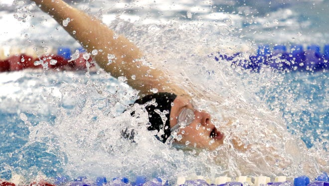 Kenyon Winkky of Horseheads on his way to winning the 100-yard backstroke during the Section 4 championships at Owego Free Academy on Feb. 20.