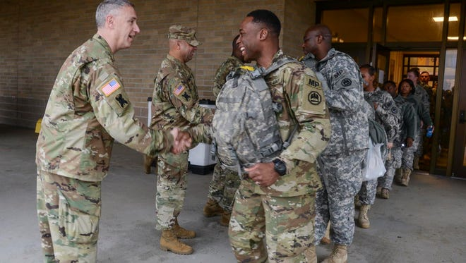 Louisiana National Guard's Lt. Col. Richard Douget, commander of the 773rd Military Police Battalion, shakes hands with soldiers as they depart for the District of Colombia to serve with the specially created Joint Task Force – District of Columbia to support the 58th Presidential Inauguration. This is the first presidential inauguration that the 773rd has conducted security operations for. (Jan. 18, 2017)
