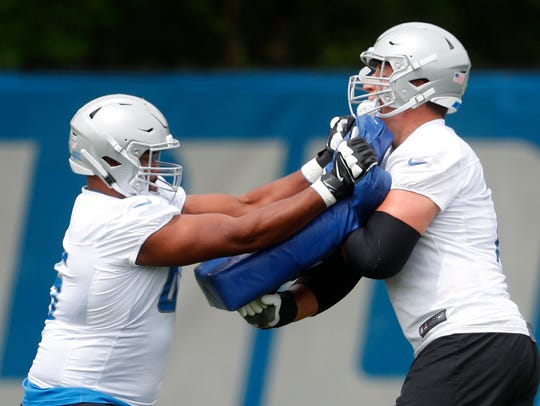 Detroit Lions offensive guard Tyrell Crosby, left,