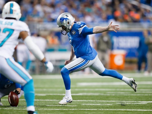 635707346711008511-AP-Dolphins-Lions-Football-