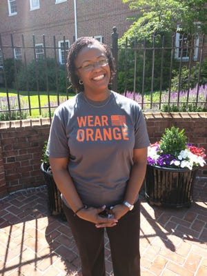 """In this May 31, 2016 file photo, York City Mayor Kim Bracey sports a """"Wear Orange"""" T-shirt, encouraging people to don the color in an effort to raise awareness about gun violence. (Sean Cotter/The York Dispatch.)"""