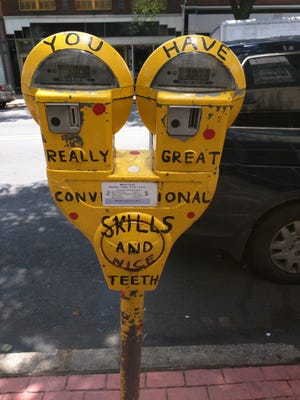 This parking meter in the WeCo district was painted by someone who apparently was very optimistic about its passersby.