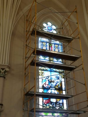 Scaffolding frames the Holy Family window at Marion's St. Mary Catholic Church.